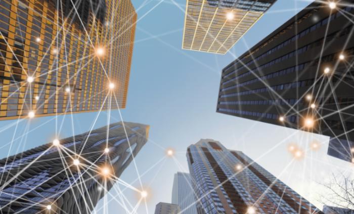Four skyscraper buildings with blockchain data points overlaid