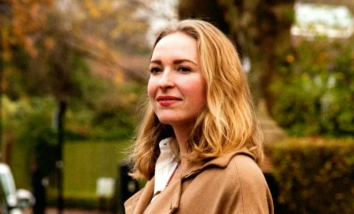 Photo of Wren Loucks with green scenery in the background