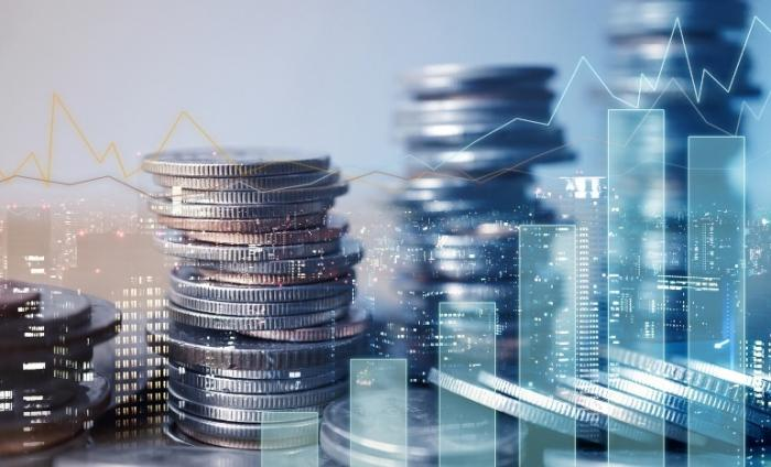 Blue double exposure of graph and rows of coins for finance and business concept