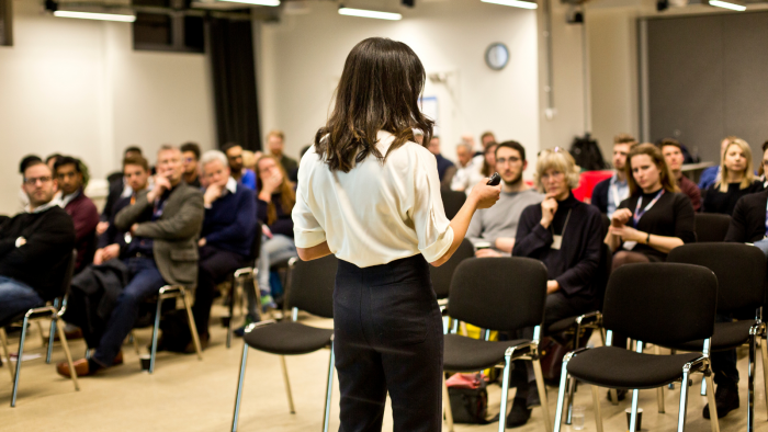 Woman delivering a pitch at University College London