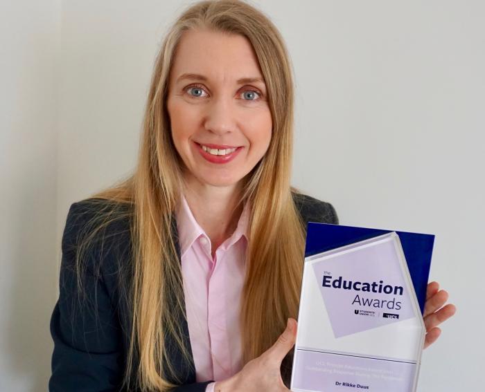 Dr Rikke Duus holding her UCL Education Award