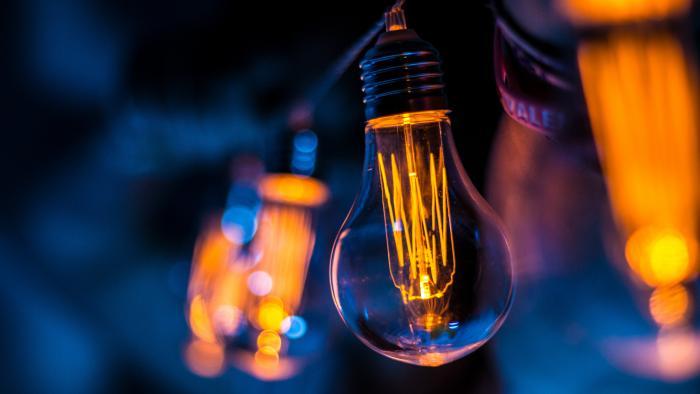 Orange and blue image of a filament lightbulb
